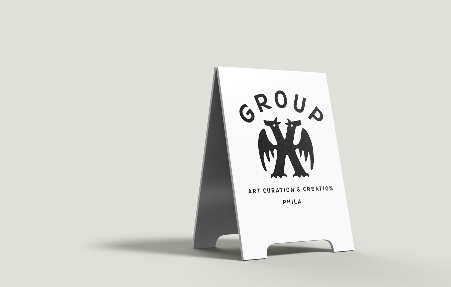 group_x_sandwich_board.jpg