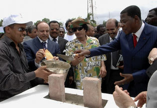 Gaddafi-and-Benin-President-Yayi-Boni-R-fix-the-first-bricks-of-a-new-Libya-Hotel-in-Cotonou-June-16-2008.-Gaddafi-is-due-to-attend-the-summit-of-heads-of-state-of.jpg