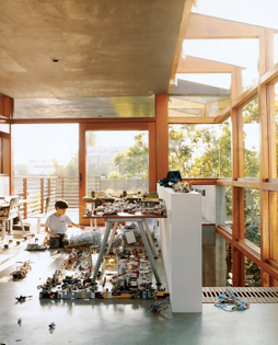 in-the-new-addition-to-the-hertzfong-residence-in-venice-california-architect-david-hertzs-son-max-tinkers-with-his-extensiv...