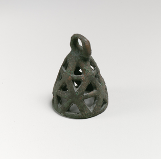 Conical in shape with openwork decoration consisting of a series of triangular perforations.