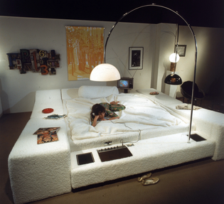 "A model atop the ""Pleasure Island"" water bed designed by Aaron Donner in a photo from 1971."