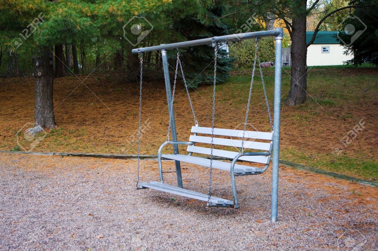 5872515-bench-swing-sits-quietly-in-the-park-.jpg