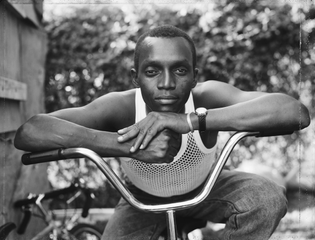 Dawoud Bey, A Young Man Resting on an Exercise Bike