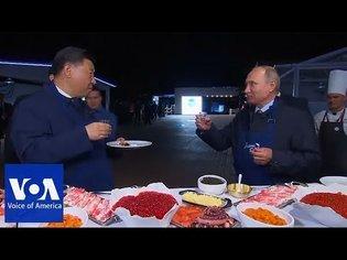 Putin and Xi make pancakes