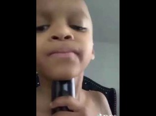 Kid uses grandmas voice box for auto tune