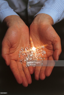 closeup-of-a-persons-hand-holding-diamonds-antwerp-flanders-belgium-picture-id89179597?s=2048x2048