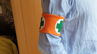Arm band calls for those with weak immune systems