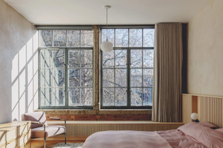 Bedroom in St. John Street warehouse apartment, London (designed by Emil Eve Architects, 2021)