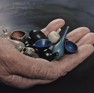 BERNDT FRIBERG, Friberg holding a group of his handmade miniature stoneware vessels, made for Gustavsberg Ab, Sweden, early 1960s.