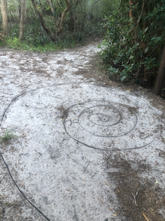 when I am walking in nature, I draw spirals with sticks to find my way back