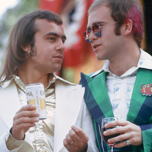elton-john-and-songwriter-bernie-taupin-attend-a-private-party-at-universal-studios-on-july-10-1973-in-universal-city-califo...