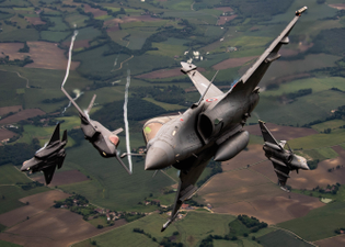 u.s._air_force_f-35as_and_french_rafales_perform_formation_flight_over_france_210518-f-bq566-9001.jpg