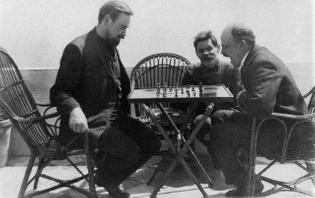 Vladimir Lenin plays chess (yelling checkmate) with Alexander Bogdanov during a visit to Maxim Gorky, Capri, Italy, 1908