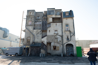 The crew built the backside of the French Dispatch building on set to capture a moment where a character walks up a visible staircase
