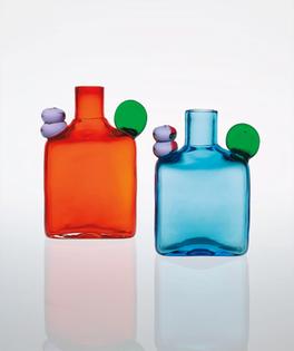 Pair of 'Pom Pom' bottles, model no. N526 designed 1970, executed 1970-1972 Coloured glass. Largest: 16.4 x 10.8 x 5.2 cm (6 1/2 x 4 1/4 x 2 in.) Produced by Nuutajärvi Notsjö, Nuutajärvi, Finland. Each underside incised with Oiva Toikka Nuutajärvi Notsjö.
