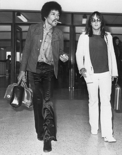 Jimi Hendrix and his road manager Eric Barrett arrive at Heathrow on way to Isle of Wight Festival, 1970.