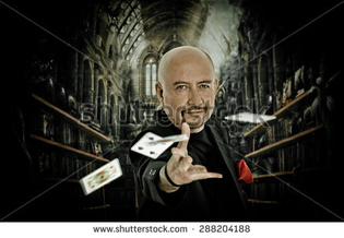 stock-photo-magician-man-posing-to-camera-throwing-cards-and-gothic-background-filtered-edition-288204188.jpg