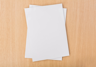 top-view-of-pieces-of-paper-on-wooden-table_1232-744.jpg