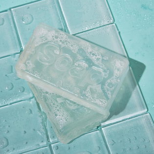 British designer @jasper.morrison has lent his famed minimal style to a no-frills translucent bar of body soap for homewares brand @supergoodthing. Read the full story on dezeen.com/design #design #accessories