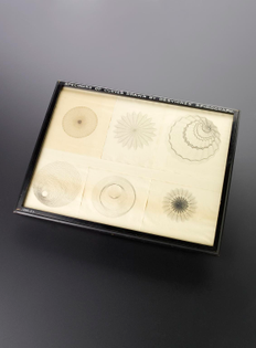 Spirograph and examples of patterns drawn using it MADE: 1886 in Vienna MAKER: Peter Hubert Desvignes