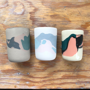 From left to right: a Meadow cup before firing, bisqued, and then glazed and finished! The colors change so much and it also shrinks significantly 💐