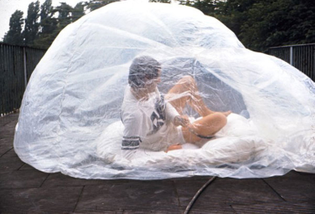 A detail of a prototype of Cushicle, an individual mobile living space by Archigram, here photographed with a dweller.