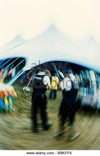 glastonbury-festival-two-police-officers-enjoy-music-playing-in-the-b8kff6.jpg
