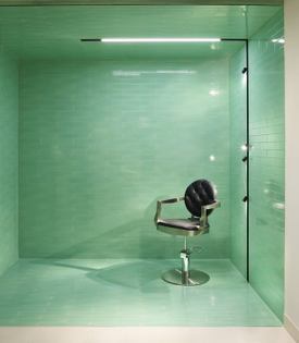 """sleek lighting and green tiling"""