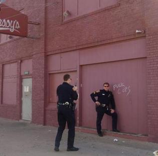 91f52de32301d46cb1bc5ca484dcf875-cops-posing-next-to-fuck-cops-graffiti.jpg