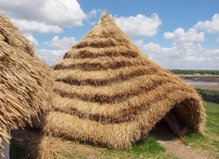 straw-neolithic-houses-thatched-built-reconstructed-chalk-daub-wheat-thatched-roofing-based-31351663.jpg
