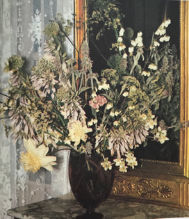 Amethyst colored vase mirror console with white, cream and pink flowers: sweet william, lamb's ears, funkia, deutzia, false jasmine, peonies, Japanese peonies, flowering ground elder and flowering leek