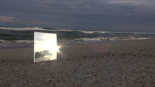 square-mirror-with-reflection-of-sunlight-on-the-beach-cubes-by-the-sea-on-overcast-day_ehzwkr-_l__f0011.png