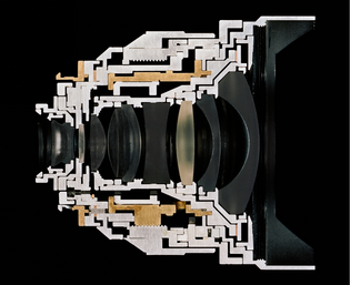 Christopher Williams  Cutaway model Zeiss Distagon T* 2.8/15 ZM Focal length: 15mm. Aperture range: 2.8-22. No. of elements/groups: 11/9. Focusing range: 0.3 m - infinity. Image ratio at close range: 1:18. Coverage at close range: 43 cm x 65 cm. Angular field, diag./horiz./vert.: 110/100/77º. Filter: M 72 x 0.75. Weight: 500 g. Length: 86 mm. Product no. black: 30 82016. Serial no.: 15555891. (Subject to change.) Manufactured by Carl Zeiss AG, Camera Lens Division, Oberkochen, Germany Studio Rhein Verlag, Düsseldorf, January 18th, 2013, 2013