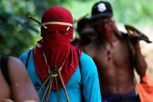 amazon-indians-strip-tie-beat-illegal-loggers.jpg