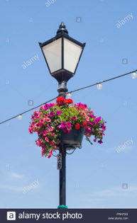 traditional-lamp-post-decorated-with-hanging-basket-of-flowers-and-with-string-of-electric-lights-penarth-sea-front-south-wa...