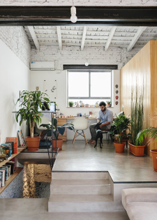 architect-hernan-landolfo-and-his-girlfriend-photographer-lucia-gentile-live-and-work-in-the-apartment-sharing-an-elevated-o...