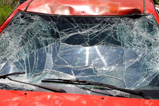41968689-broken-windshield-at-red-car-in-traffic-accident.jpg