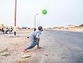 Child playing football.jpg