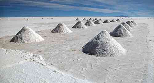 """""""One of the biggest environmental problems caused by our endless hunger for the latest and smartest devices is a growing mineral crisis, particularly those needed to make our batteries,"""" says Christina Valimaki an analyst at Elsevier. In South America, the biggest problem is water. The continent's Lithium Triangle, which covers parts of Argentina, Bolivia and Chile, holds more than half the world's supply of the metal beneath its otherworldly salt flats. It's also one of the driest places on earth. That's a real issue, because to extract lithium, miners start by drilling a hole in the salt flats and pumping salty, mineral-rich brine to the surface.  It's a relatively cheap and effective process, but it uses a lot of water – approximately 500,000 gallons per tonne of lithium. In Chile's Salar de Atacama, mining activities consumed 65 per cent of the region's water. That is having a big impact on local farmers – who grow quinoa and herd llamas – in an area where some communities already have to get water driven in from elsewhere."""